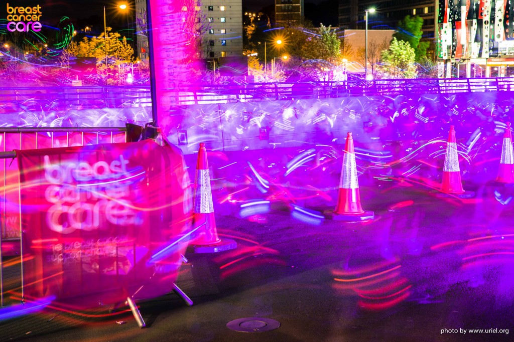 Electric Run pink breast cancer care logo lights